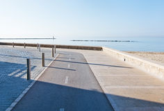 Biking lanes boardwalk. And string of rocks with birds on a sunny and calm winter day in December in Majorca, Balearic islands, Spain Stock Photo