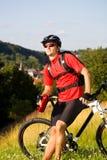 Biking man Stock Image