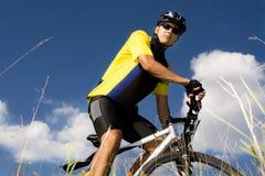 Biking man Stock Images