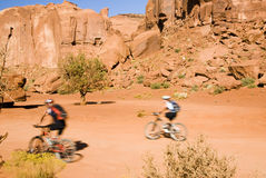 Biking in Monument Valley. A couple biking through Monument Valley Stock Photos