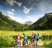 Biking in mountains. Mixed group of cyclists  outdoors Stock Photography