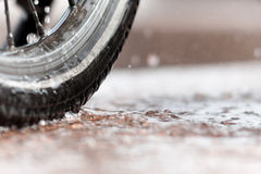 Biking in pouring rain Royalty Free Stock Photography