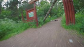 Biking POV in the park after a violent storm. POV Mountain bike riding in the park after the storm. Fallen tree at the entrance to the park stock footage