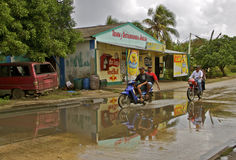 Biking on rain soaked road in the tropics Stock Photo