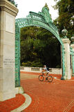Biking through Sather Gate Royalty Free Stock Images