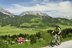 Biking in Schladminger Tauern Royalty Free Stock Photo