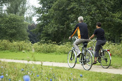 Biking Seniors In The Park Royalty Free Stock Images