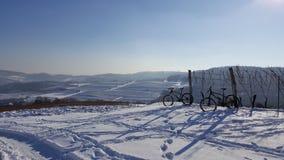 Biking in the snow stock photos