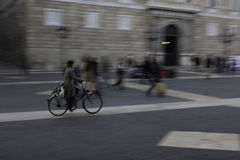 Biking in the square of St. Jaume in Barcelona. Biking in the square in Saint Jaume, gothic neighborhood royalty free stock images