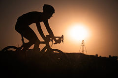 Biking on sunset background Royalty Free Stock Photos