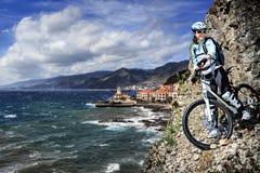 Biking to the peak Royalty Free Stock Photos