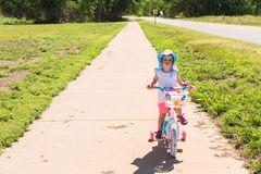 Biking. Toddler learning how to ride her first bike Stock Images