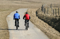 Biking tour. Two people on a biking tour royalty free stock photos