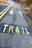 Biking Trail. The word trail painted on a biking path directs traffic Royalty Free Stock Photos