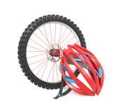 Biking wheel and helmet Royalty Free Stock Photos
