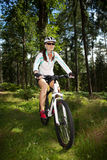 Biking woman Stock Photos