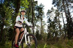 Biking woman Royalty Free Stock Photography