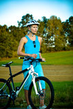 Biking woman Royalty Free Stock Image