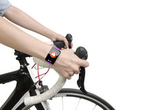 Biking woman hands wearing health sensor smart watch Royalty Free Stock Photos