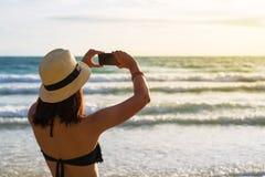 Bikini asia woman taking photo Royalty Free Stock Image