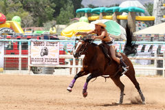 Bikini Barrel Racing. Cowgirl racing in preliminary heat of The Heat III: Bikini Barrel Race and Roughstock Challenge rodeo in Belen, New Mexico stock photos