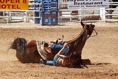 Bikini Barrel Racing Crash. Cowgirl and horse fall while competing in preliminary heat of The Heat III: Bikini Barrel Race and Roughstock Challenge rodeo in royalty free stock photos