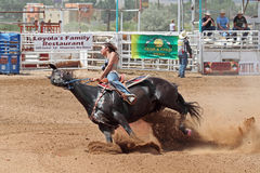 Bikini Barrel Racing Leaning Hard. Cowgirl and horse leaning hard turning around barrel in preliminary heat in The Heat III: Bikini Barrel Race and Roughstock royalty free stock photography