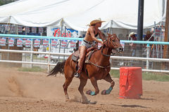 Bikini Barrel Racing Next Barrel. Cowgirl racing for next barrel while competing in preliminary heat in The Heat III: Bikini Barrel Race and Roughstock Challenge stock photos