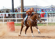 Bikini Barrel Racing Next Barrel. Cowgirl racing for next barrel while competing in preliminary heat in The Heat III: Bikini Barrel Race and Roughstock Challenge stock photography