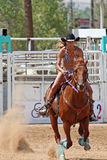 Bikini Barrel Racing - Out of the Gates. Cowgirl and horse race toward first barrel while competing in preliminary heat in The Heat III: Bikini Barrel Race and stock images