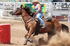 Bikini Barrel Racing Power Turn. Cowgirl turning around barrel in preliminary heat of The Heat III: Bikini Barrel Race and Roughstock Challenge rodeo in Belen royalty free stock photos