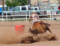 Bikini Barrel Racing Power Turn. Cowgirl turning around barrel in preliminary heat in The Heat III: Bikini Barrel Race and Roughstock Challenge rodeo in Belen stock images