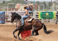 Bikini Barrel Racing Tight Turn. Cowgirl takes tight turn around barrel in preliminary heat of The Heat III: Bikini Barrel Race and Roughstock Challenge rodeo in royalty free stock image