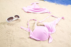Bikini on beach Stock Images