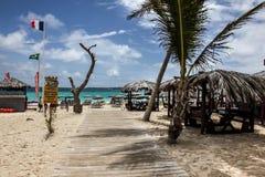 Bikini beachy entrance on Orient Bay. ST.MAARTEN - AUGUST 2: Bikini beachy entrance on Orient Bay Baie Orientale area  in Sint Maarten, seen in St.Maarten on Royalty Free Stock Images