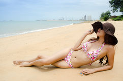 Bikini. Beautiful lady wear bikini laying on the beach Royalty Free Stock Photos