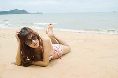 Bikini. Beautiful lady wear bikini laying on the beach Stock Photos