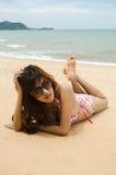 Bikini. Beautiful lady wear bikini laying on the beach Royalty Free Stock Image