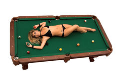 Bikini Billiards. Young Asian bikini model laying on top of a pool table Isolated over white royalty free stock photos