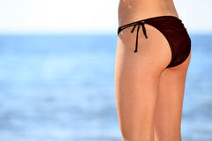 Bikini bottom model. Shapely bum in swimsuit on the background of the sea Stock Image