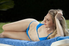Bikini clad woman on chaise Royalty Free Stock Photography