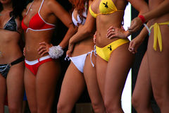 Bikini Competition. White red yellow models Stock Photo