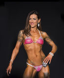 Bikini Contestant Wears Tattoos and a Smile Royalty Free Stock Photos