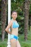 Bikini girl. A pretty young chinese girls, wearing a bikini Stock Photo