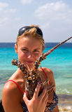 Bikini Girl. With big lobster Royalty Free Stock Images