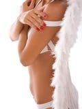 Bikini girl with angel wings. Beautiful woman in white bikini and white angel wings Royalty Free Stock Photography