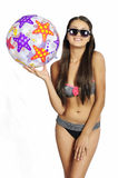 Bikini girl with a ball Stock Photos