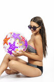 Bikini girl with a ball Royalty Free Stock Images