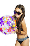 Bikini girl with a ball Royalty Free Stock Photography
