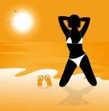 Bikini girl on the beach Royalty Free Stock Image